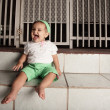 Baby laughing on a stair — Stock Photo