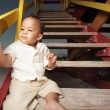 Baby sitting on the stairs — Stock Photo