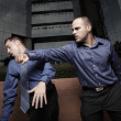Businessman hitting another businessman — Stock Photo #2587866
