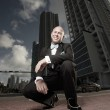 Unusual perspective of a man in a tux in the city — Stock Photo #2588501