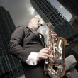 Man playing the saxophone downtown — Stock Photo #2588526