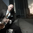 Man playing the sax downtown — Stock Photo #2588540