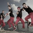 Male break dancing group — Stock Photo