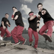 Male break dancing group - Stock Photo