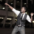 Young African American male dancing in the street — Stock Photo