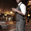 Foto de Stock  : Trendy African American male in the city