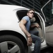 Superstar getting out of the car — Stock Photo