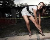Woman bending over and glancing away — Stock Photo