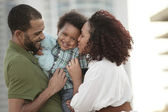 Happy young African American family — Stock Photo