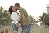 Attractive young couple at the beach — Stock Photo
