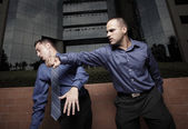 Businessman hitting another businessman — Stock Photo