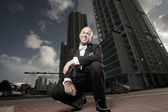 Unusual perspective of a man in a tux in the city — Stock Photo