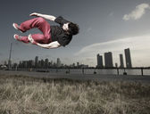 Man performing a midair stunt — Stock Photo