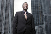 Young African American businessman in the city — Stock Photo