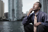 Businessman confused looking away — Stock Photo