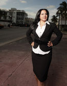 Businesswoman with hands on hips — Stock Photo