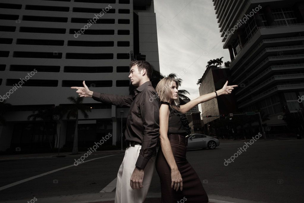 Couple pointing finger guns in the city  Stock Photo #2586724