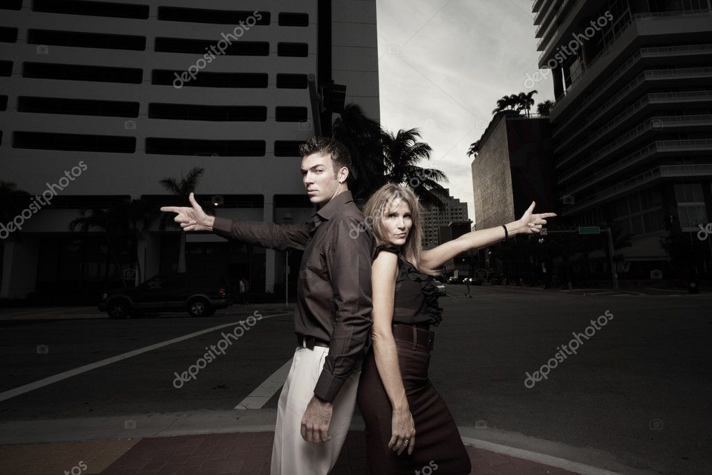 Couple pointing finger guns in the city — Stock Photo #2586726