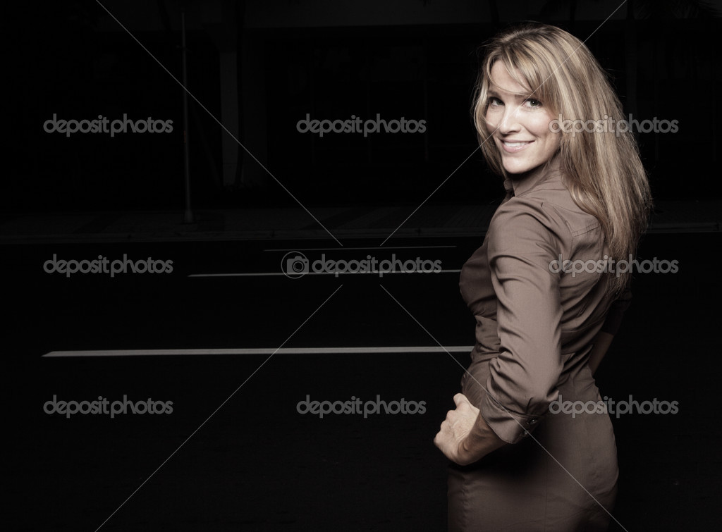 Beautiful woman on a black background — Stock Photo #2586840