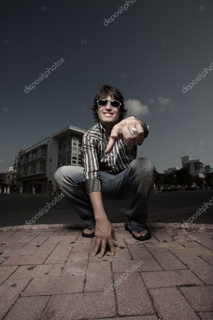 Young man pointing at the camera — Stock Photo #2587583