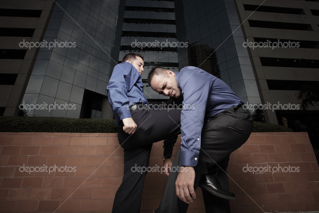 Businessman kneeing another businessman — Stock Photo #2587872