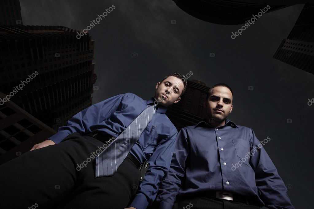 Two businessmen looking downward — Stock Photo #2588077