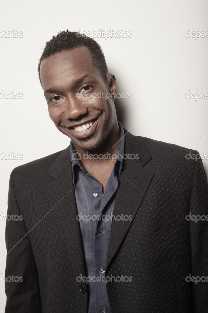Handsome young man smiling  Foto Stock #2588872