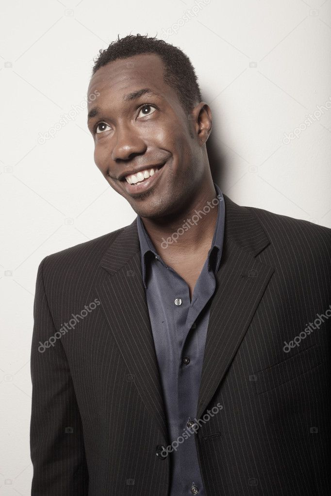 Handsome young man smiling — Stock Photo #2588873