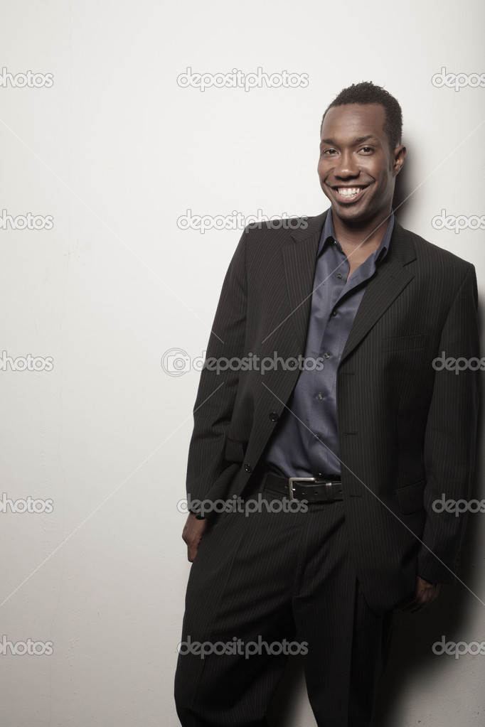 Handsome man posing on a white background — Photo #2588877