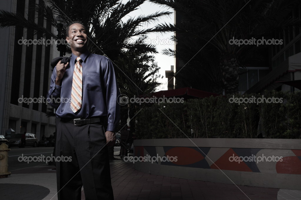 Young African American Businessman smiling — Photo #2588897