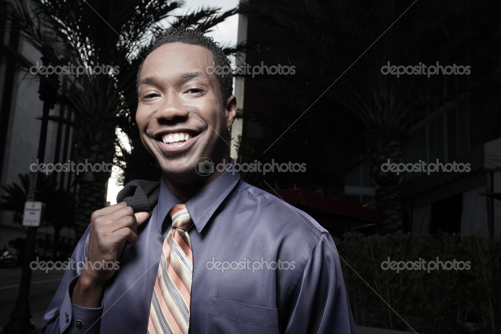 Handsome African American businessman smiling — Stock fotografie #2588898