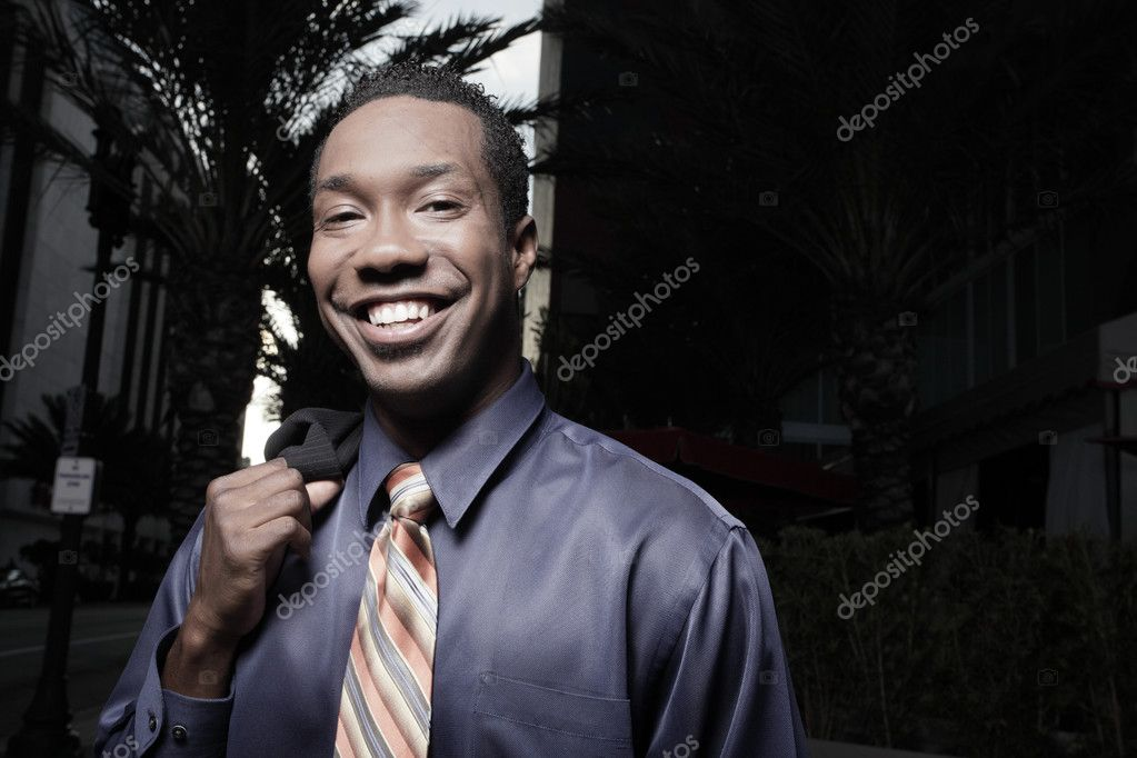 Handsome African American businessman smiling — Photo #2588898