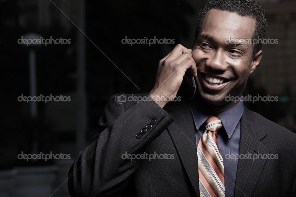 Young happy businessman on a talking on a cellular telephone — Stock Photo #2588952