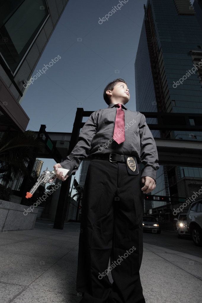 Image of a child sheriff with a silver gun  Stock Photo #2589496