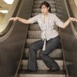 Woman posing on a escalator - Stock Photo