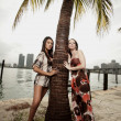 Two models and a palm tree — Stock Photo