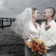 Stok fotoğraf: Young newlywed couple by bay