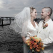Стоковое фото: Young newlywed couple by bay