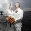 Young newlywed couple by the bay — Stock Photo