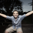 Stock Photo: Boy with arms outstretched