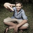 Boy showing a peace sign — Foto Stock
