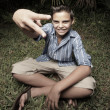 Boy showing a peace sign — Stock Photo