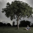Boy meditating under a tree — Foto Stock