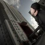Man looking upward at a modern building — Stock Photo