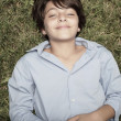 Stock Photo: Boy laying on the grass