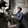 Boy and a cactus plant — Stock Photo