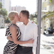 Young couple kissing on teh street — Stock Photo #2597556