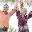 Couple with arms outstretched - Stock Photo