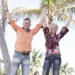 Couple with arms outstretched — Stock Photo