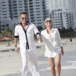 Stock Photo: Young couple walking on the beach
